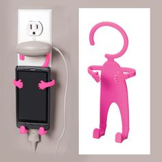 "Flexi Holder (Pink) - Wraps its arms around your cell phone, iPod or GPS. Hang it from the rear view mirror, the corner of a computer screen, a belt loop or treadmill. Use it when charging your phone, hang it on the wall to hold keys, stand it up or lay it flat to listen to music. Comes with notepad. Made of bendable silicone so it won't scratch surfaces. (7-1/2""H) PN-SM6586 $12.98 CAD"
