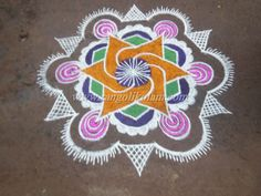7-5 in between dotted design kolam with colour on karthigai month