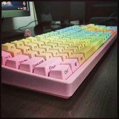 Side printed rainbow caps on a pink Filco - Instagram photo by @os30166 (Kiwi)