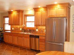 Oak cabinets, Luxury vinyl floor tile, tile backsplash and stainless appliances