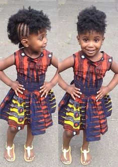 Lovely little girl in an adorable African print dress. You can't beat that smile!! such a cutie!!