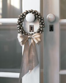 sounds of sleigh bells--a jingle wreath reminds us of the magic of Christmas every time the door opens...