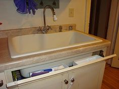 Tip out sink tray {featured on Home Storage Solutions 101}
