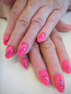 This summer`s hottest colour, HOT PINK!  Seen here is Bio Sculpture Gel colour #105 (Jinkie Pink) with black filagree designs done with a stamping template by KONAD & hilighted with irridescent glitter.