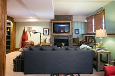 A new seating arrangement allows for the family to sit together with the flagstone fireplace and TV as the focal point in the room.