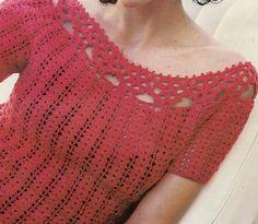 Blusa a crochet con rosetas