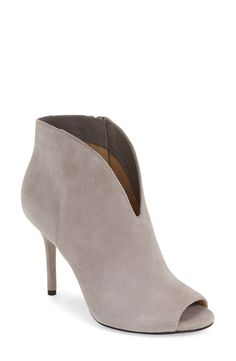 A daring V-cut vamp and lush suede lend signature polish to these shapely open-toe bootie. Pairing these beauties with denim for an ultra-chic look.