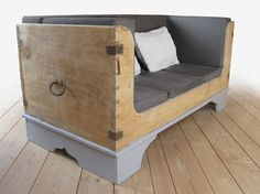 old chest repurposed into a sofa.  Coolness factor is through the roof on this thing.