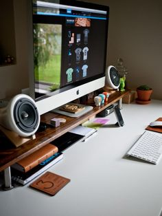 iMac and ceramic speakers workspace.