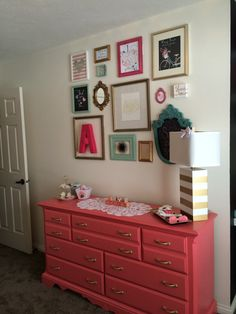 Gallery Wall + Coral Changing Table = Nursery Love!