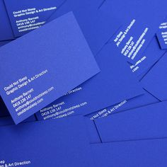New business cards printed on blue stock with white ink.