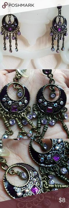 """Bronze Tone Purple Rhinestone and Enamel Earrings I cannot remember where I got these. They are about 2.5"""" long and I am unsure of the metal. The large enamel circle is 1"""" wide. Very elaborate and sparkly. There's something kinda Paisley Park about them. Very light weight for larger earrings. My kitchen scale says one earring weighs a quarter of an ounce. I'll put em in a lil jewerly box when I ship them. Jewelry Earrings"""