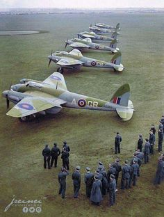 De Havilland Mosquitoes and crew at a airfield.