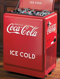Provide ice cold drinks to your guests while they enjoy the entertainment of your media room with the Refrigerated Rolling Coca-Cola Cooler; an identical replica of a retro original cooler. Coca Cola Cooler, Coca Cola Drink, Cola Drinks, Coca Cola Bottles, Pepsi, Bar Retro, Retro Cooler, Coca Cola Decor, Coke Machine