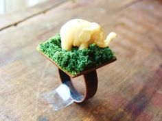 Ring. Elephant in Tall Grass. Miniature Ivory Elephant Ring on Antiqued Copper Band. 25 mm. $24.00, via Etsy.
