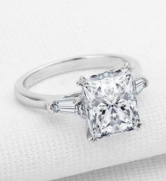 Our impressive custom handmade moissanite wedding ring set, from Camellia Jewelry, will take her breath away. Custom handcrafted in the finest details, this unique engagement ring set features a carat round cu Engagement Solitaire, Princess Cut Rings, Beautiful Engagement Rings, Princess Cut Diamonds, Diamond Wedding Rings, Bridal Rings, Engagement Ring Settings, Vintage Engagement Rings, Diamond Engagement Rings