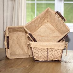 You'll love this rustic basket, with burlap fabric lining and chicken wire frame. You can almost imagine these being used to gather eggs on a farm. Perfect for storing craft supplies, office supplies or items in your bathroom.