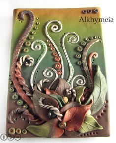 Daniela D'Uva  of Alkhymeia is the creator of this very fall-esque ATC. All those swirls and the lines of dots running alongside them actual...