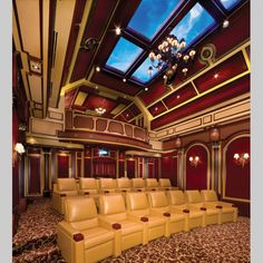 Extravagant Home Theater with balcony in the Cayman Islands - more than just a theater, it has a snack bar, lobby, bathroom and stage. The space is 34' x 25' with 22' fiber optic ceilings - tall enough for the balcony. The theater offers 19 custom seats and bar stools on the ground floor and an additional 12 seats in the balcony.
