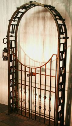 Railroad Spike Design Ironwork Garden Arbor with Gate | eBay  This would be so cool, but it would be a HUGE feet (sp?) lol