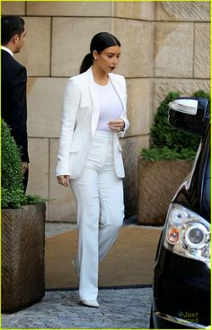 Kim Kardashian and her husband Kanye West rock white suits while exiting their hotel in Prague, Czech Republic
