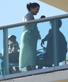 So much to smile about: The actress, 42, looked utterly radiant as she appeared make-up free on the balcony of her hotel, wearing a patterned robe as she enjoyed a spot of breakfast