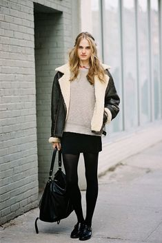 Elinor Weedon wears an Acne shearling lined jacket with a mini skirt.