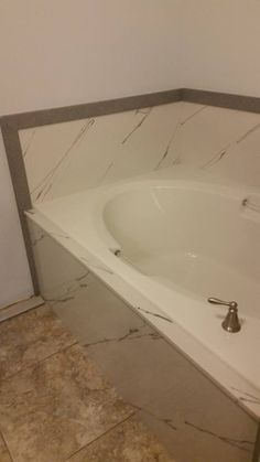 Half tub surround with straight veining. Cultured Granite trim around it by R&S Marble. Tub Surround, Granite, Bathrooms, Marble, Bathroom, Marbles, Bath
