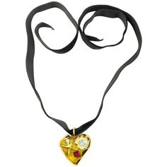 Preowned Christian Lacroix Yellow Heart Shaped Gold Toned Black Velvet... ($280) ❤ liked on Polyvore featuring jewelry, necklaces, pendant necklaces, yellow, star necklace, yellow necklace, vintage pendant necklace, vintage jewelry and vintage heart necklace