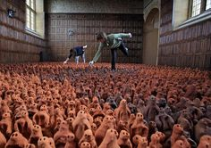 Local volunteers Francis Aitken (R) and Deborah Westmancote (L) place some of the 1000s of clay figures that will make up part of Antony Gormley's 'Field for the British Isles' exhibit.