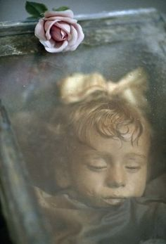 Rosalia Lombardo, is an Italian child mummy.  She died in 1920 at the age of two. She's almost perfectly preserved even though she's been dead for 93 years. She still has all her organs, skin, and even eyes and.... Her EYES OPEN AND CLOSE!! It's due to temperature change (they think) but seriously, that's too much! Eyes give me the heebie-jeebies!