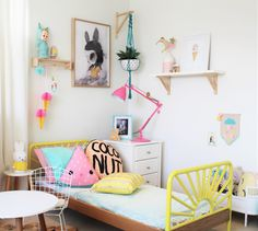 This bedroom is bursting with color and quirky details, including a bright yellow headboard and hanging paper ice cream cones. Childrens Bedroom Furniture, Diy Home Decor Bedroom, Small Room Bedroom, Kids Bedroom, Bedroom Ideas, Girl Bedrooms, Kids Rooms, Yellow Headboard, Rooms Decoration
