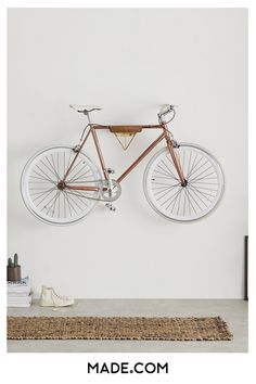 With a blend of natural wood and a sleek brass plate, Dayde's as much a piece of wall art as functional bike storage. It's not just about looks. Our bike stands are designed to hold up to of weight. They're the perfect partner to our city bike collect