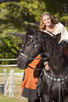 Sandra Beaulieu and her Friesian horse Douwe on the set of Essential Realism, an indie film directed by Alan Dillingham. Douwe got to play a magical unicorn! Photo taken by Jesse Schwarcz at Safe Haven Farm in Durham, ME. www.beginthedance.com