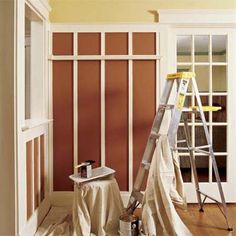 ladder, paint, painting tray, brush and tarp in a beautifully painted interior room; another wainscotting pattern