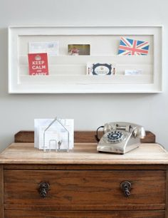 This framed display board is a wonderful idea to store and present postcards, business cards and keepsakes. Comprises of a distressed antique white wooden frame with white fabric pockets inside . Perfect for the kitchen, office or hallway.