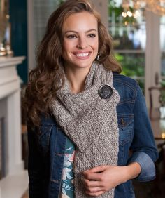This clever scarf features a button and button hole so it will stay fashionably in place. The diamond knit stitch looks perfect in any solid colour yarn.