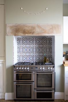 "Range cooker in chimney breast From ""Lay the table, a lovely leeds baking and f. - Before After DIY Living Room Renovation, Living Room Kitchen, Kitchen Cooker, Room Renovation, Kitchen Remodel, Kitchen, Kitchen Tiles, Kitchen Backsplash Tile Designs, Kitchen Chimney"
