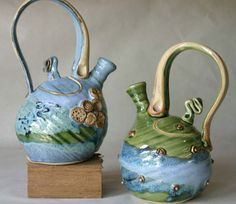 Too cool Mosquito Mud Pottery - freaky teapots!