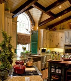 cottage_kitchen_style_french_country_tudor_exposed_beams_oak_cabinets_marble_chandelier_colonial_shutters_topiary_island_hardwood_1352850901.jpg (338×384)