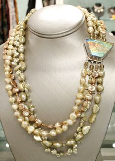 """Rainbow"" clasp (7 layers, 12 pcs glass fused) hand bezeled in sterling silver; 4 strand necklace is 19"" of large yellow natural shaped freshwater pearls, Keshi freshwater and leaf-shaped pearls, crystal and copper seed beads, peach freshwater pearls and citrine topaz.  Please inquire for price and availability."