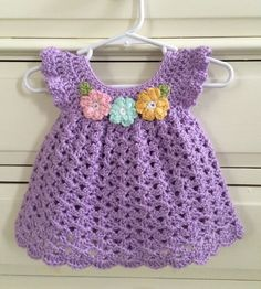 Hand Crocheted Baby Dress. Size: Newborn - 3 months. Color : Soft Lilac Material: Caron Simply Soft 100% acrylic yarn. Dress has 2 small plastic button at back nape of neck. Care: Caron yarn is machine washable and dry able. I suggest hand wash and lay flat to dry for best results.