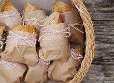 Love this picnic shot of sandwiches wrapped in paper with red twine! Neat way to…