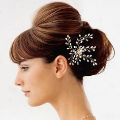 a better flower but I like the poof and bun placement. could even  do a pretty embleshed head band.
