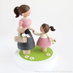This beautiful mother and daughter figurine set would be a treasured gift at a baby shower, for a baby girls nursery, or a really special gift for your mom. This item is ready to ship! The two figurines have been handmade from long, narrow strips of rolled paper, shaped and detailed all by hand. It would be a beautiful addition to a nursery or little girls room, or would look lovely on a family mantle or shelf. Everything is made from paper, except the base, which is wood. This special item…