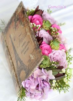 Cool Idea....with your love of books Cassidy, we could hollow out old books, make them look vintage and put a flower arrangement in them. So different....but so cool...add pearls and bling.....