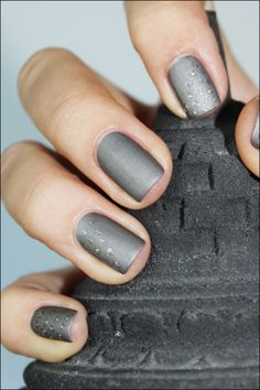 grey nails with subtle dot design