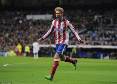 Fernando Torres celebrates opening the scoring for Atletico Madrid after just 49 seconds a...