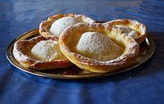 Knieküchle- a fried pastry sprinkled with powdered sugar. My great grandma, who came to America as a young woman from Bohemia (currently Czech Republic), always made this dessert. Sweet memories!