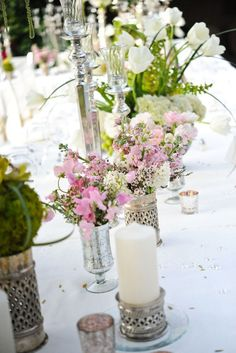 Love this table and floral arrangements.